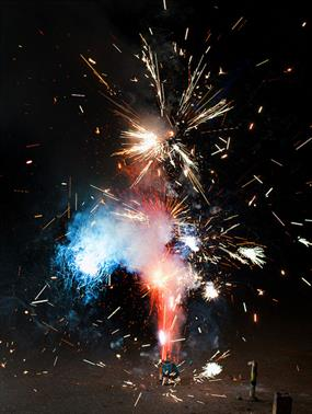 Photo of a firework exploding in red, white, and blue sparks