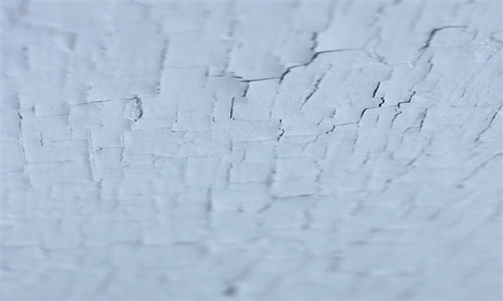 Cracked paint on wall