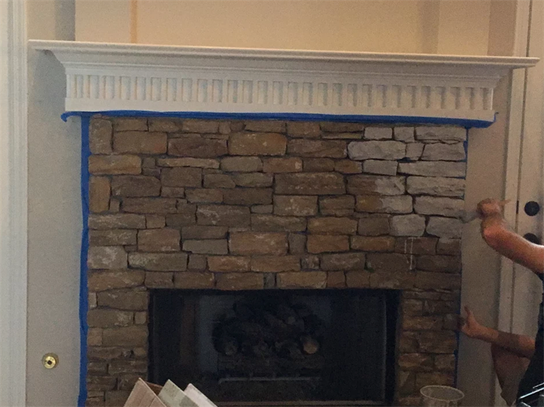 Partially White-Washed Stone Fireplace