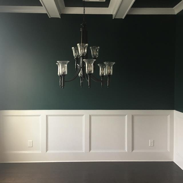 green dining room with hanging light fixture