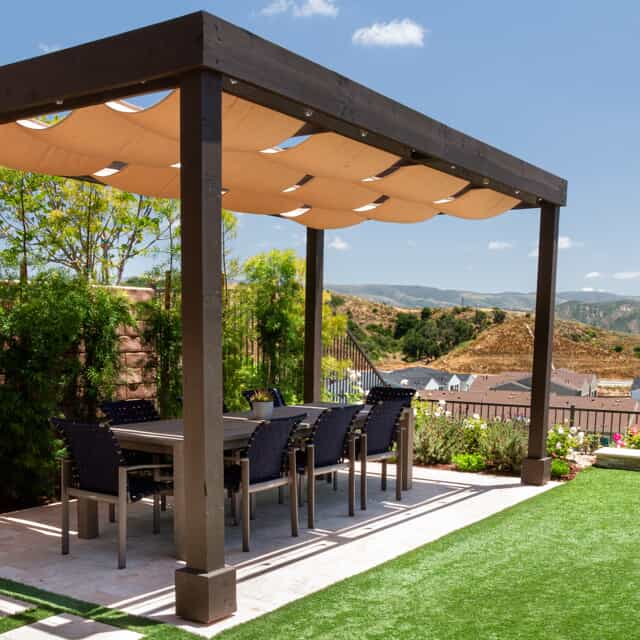 backyard patio and gazebo with grass lawn