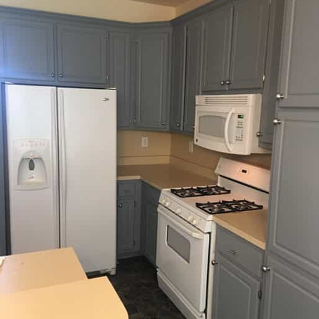 gray kitchen with white appliances