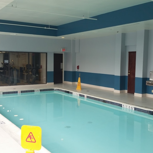 commercial swimming pool with blue walls