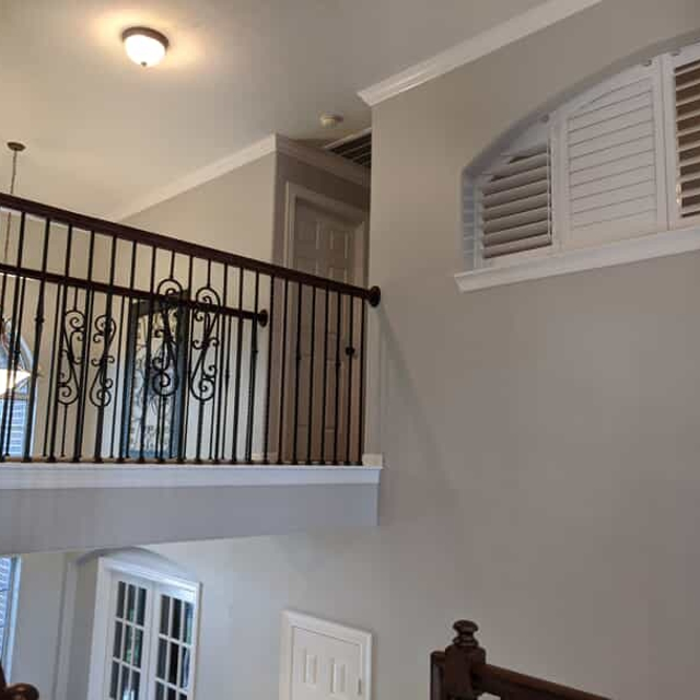 Gray home interior wall and handrail
