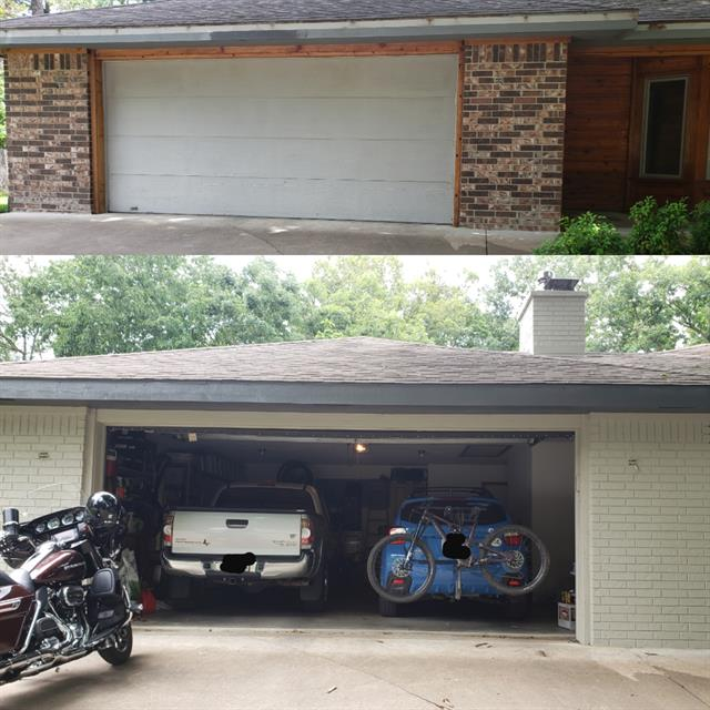 garage open with two cars and a motorcycle