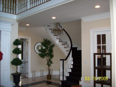 Home Staircase and Entryway with Beige Walls and White Trim