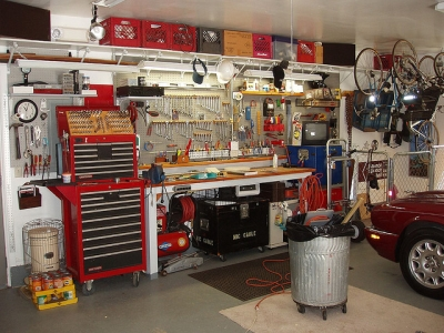 Picture of a workshop bench in front of a red car
