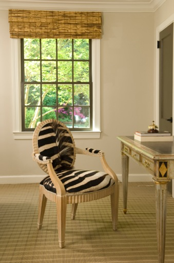 Faux zebra fur upholstered desk chair with neutral wood arms and legs