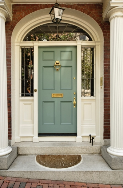 Attractive Front Pork with Olive Green Door, Columns, and Brick Accents
