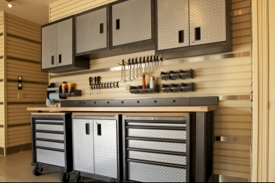 Silver and black garage work bench and cabinets