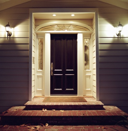 Solid door in well lit entryway