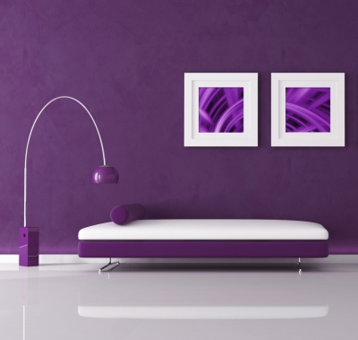 Modern, minimalist room with purple walls, furniture and artwork with white accents