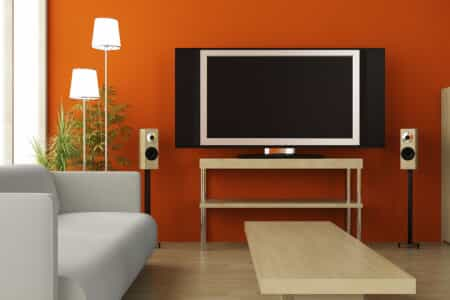 Couch and TV in an Orange Colored Room