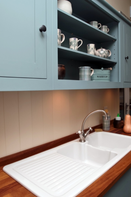 Light Blue Cabinets and Shelving in a Kitchen