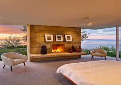 Large stone fireplace in a bedroom
