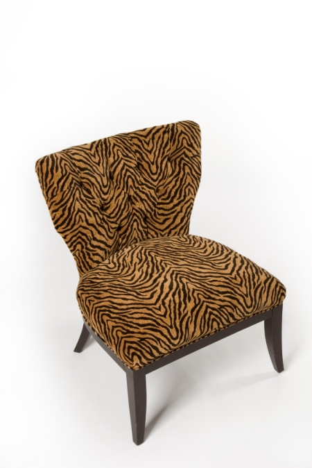Orange and brown striped animal print chair with dark brown legs