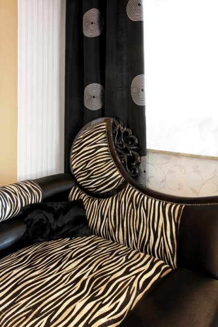 Modern zebra print and dark brown leather love seat