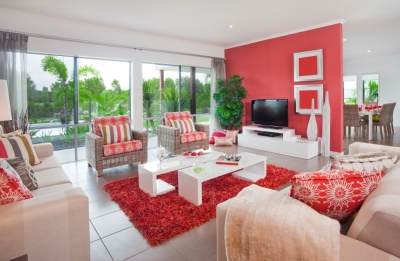 White Walls in a Room Filled with Red Furniture