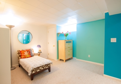 Basement bedroom with blue accent walls