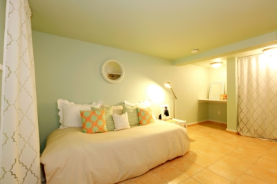 Master Bedroom with Mint Walls and Light Yellow Ceiling