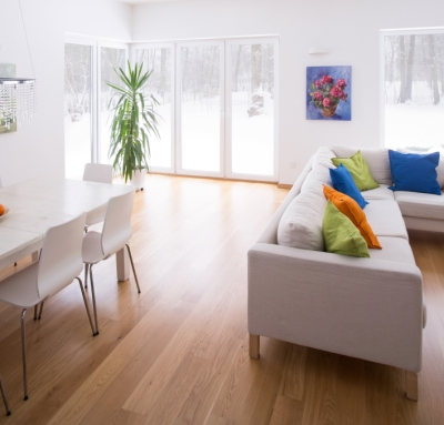 White Walls in Room with Colorful Paintings Hanging Up