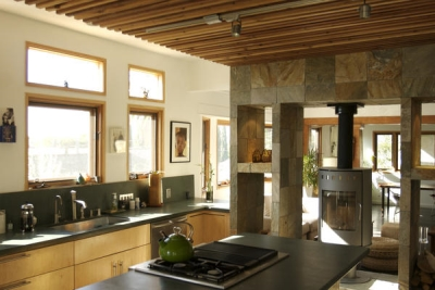 Kitchen with stone and wood accents