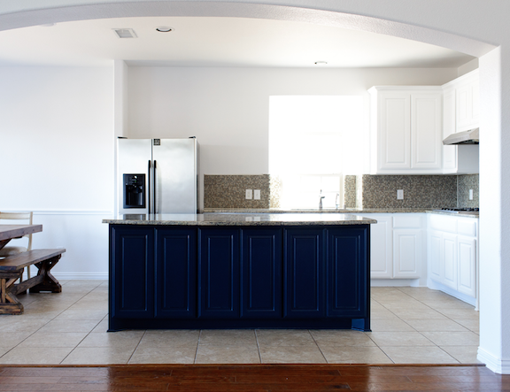 white cabinets with blue island kitchen