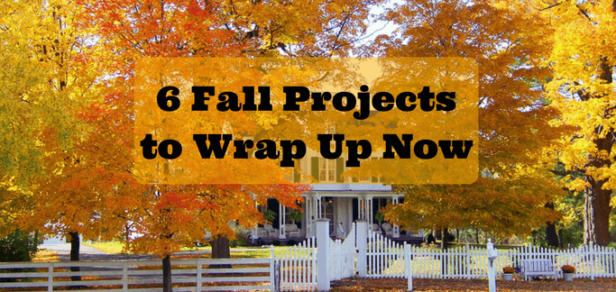 6 Fall Projects to Wrap Up Now image of white farmhouse surrounded by yellow and orange maple trees