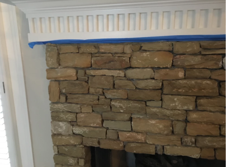 Stone Fireplace with White Molding