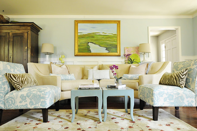 Living room with blue-patterned fabric chairs and cream colored couch