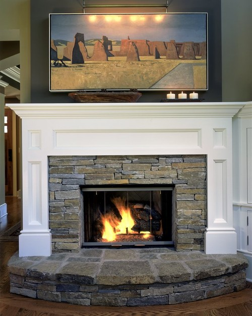Fireplace with a painting over it