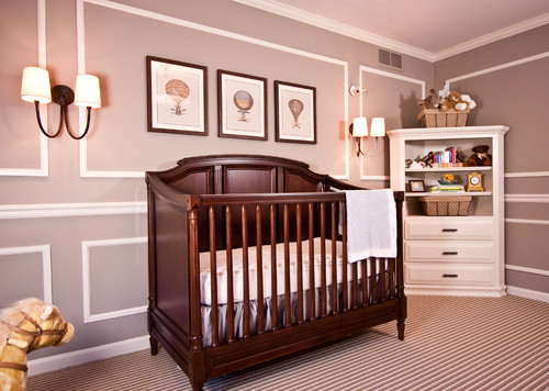 Wooden crib in a mauve-painted bedroom