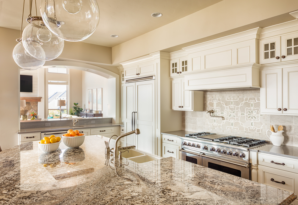 Recently remodeled, off-white kitchen with white cabinets and granite countertops