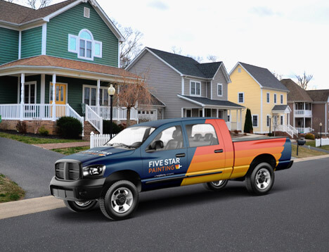 Blue Five Star painting truck with logo parked on the street in front of a house.