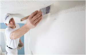 Painter Working on White Ceiling