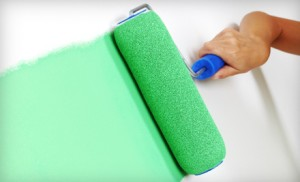 Green Paint Roller on Wall