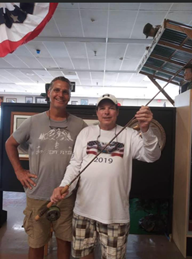 two men with one holding a fishing rod